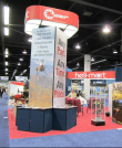 Island Booth With Tower and Rotating Sign